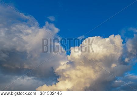 A Few Light Cumulus And Cirrus Clouds In A Clear Blue Sky. Summer Bright Image Of The Sky.