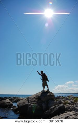 Silhouette Of Man Showing Sign Of Success