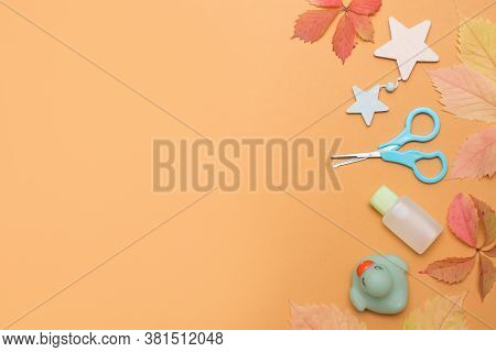 Baby Autumn Bathing Flat Lay. Children Cosmetics Set On Yellow Background, Copy Space For Text.