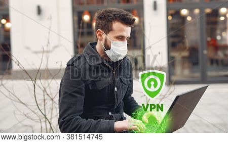 Man Using Laptop With Protected By Vpn