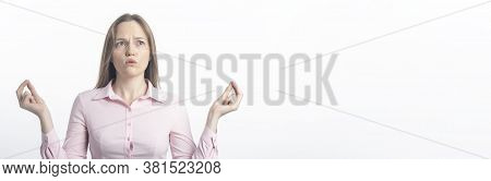 Businesswoman Holding Fingers Together Trying To Calm Down Over White Studio Background. Meditate Or