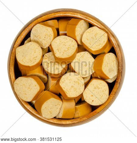 Slices Of Vegan Vienna Sausages In A Wooden Bowl. Parboiled Sausages, Made Of Tofu, Smoked At Low Te