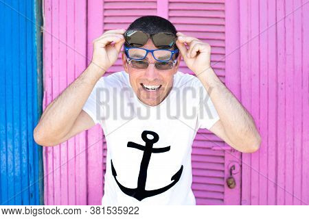 Nice Attractive Funny Happy Guy Wear Sailor Shirt Feel Cool With Three Pears Of Specs Enjoy The Summ