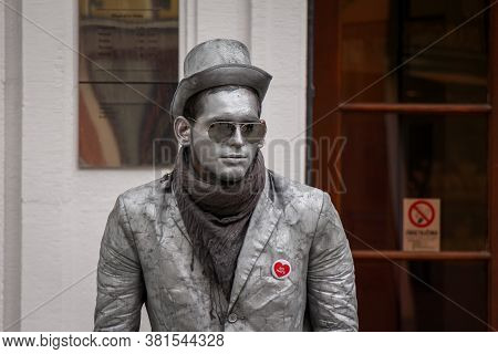 Bratislava, Slovakia - July 5th 2020: A Street Performer Mimicking The Silver Statues In The Old Tow