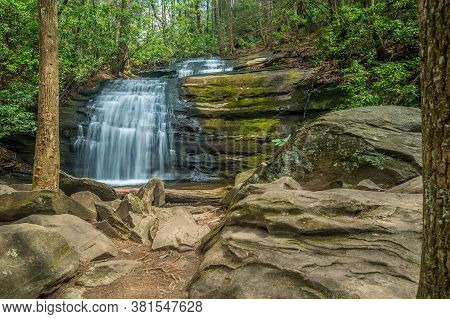 Long Creek Falls Is A Scenic Waterfall Surrounded By Large Boulders And The Forest With Hiking Trail