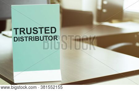 Blue Board With Text Trusted Distributor On The Office Background