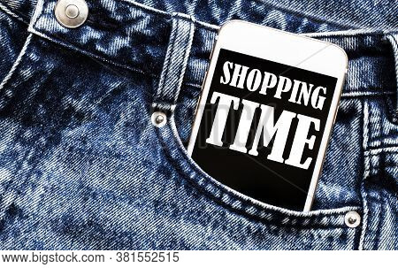 White Phone With Text Shopping Time Lies In Jeans Pocket