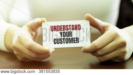 Businesswoman Holding A Card With Text Understand Your Customer