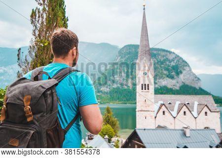 Strong Young Man Looking At Hallstatt Church