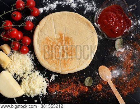 Cooking pizza. Black kitchen table and pizza ingredients