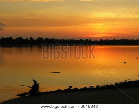 Fisherman At The River