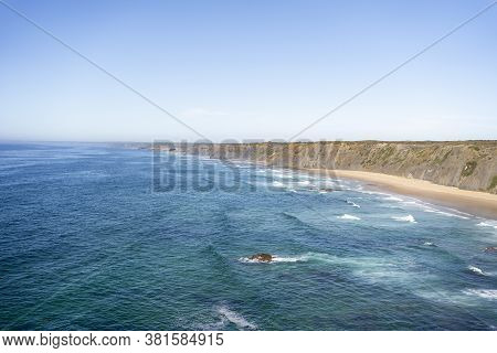 Wild Untouched Empty Secret Beach Seascape. Seaside View From The Cliffs To The Ocean. Sea Landscape