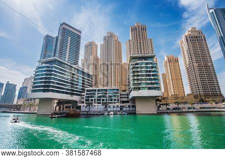 Dubai Marina Water Canal With Promenade And Modern Buildings, Uae. Luxury Travel Concept.