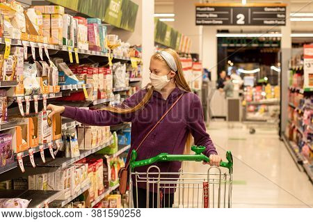 Sydney, Australia - 2020-08-15 A Girl Wearing Handmade Face Covering Mask With The Shopping Trolley