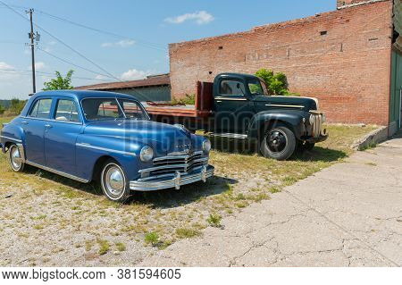 Galena Usa - September 7 2015; Classic American Blue Plymouth Car And Black Ford  Truck Parked Along