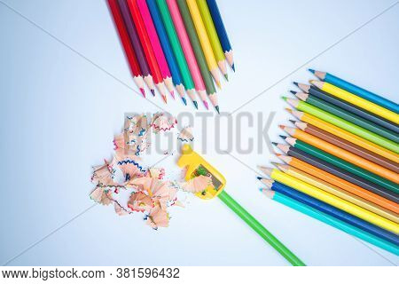 Back To School Concept. Top-down Of The Colored Pencils And Pencil Shavings Along With Yellow Pencil