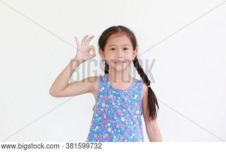 Portrait Asian Little Child Girl Show Finger Okay Symbol Sign Language Isolated On White Background.