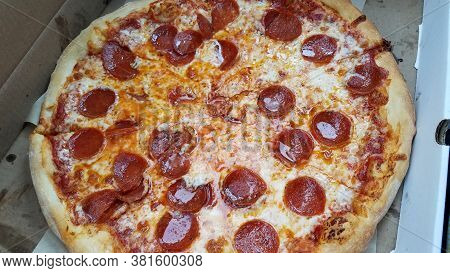 Greasy Hot Pepperoni And Cheese Pizza Slices