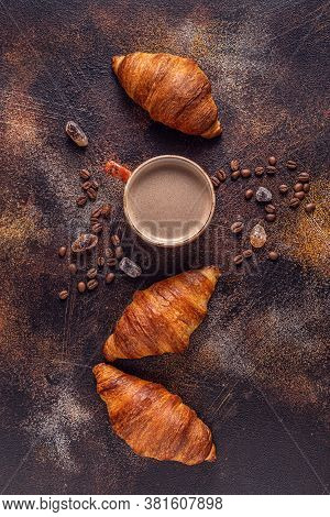 Coffee And Croissant On Stone Background. French Breakfast. Top View With Copy Space.
