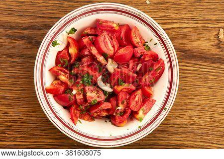 Tomato Salad On White Plate Ready To Eat