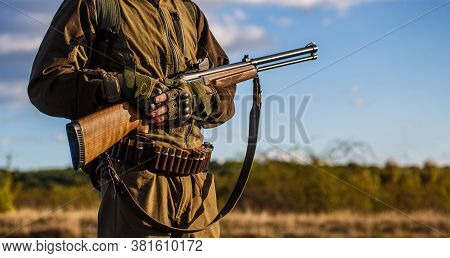 A Hunter With A Hunting Gun And Hunting Form To Hunt. The Man Is On The Hunt. Hunting Period. Male W