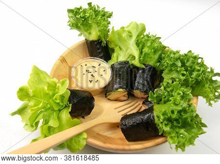 Fresh Seaweed Asian Salad Rolls With Dipping In Wooden Bowl