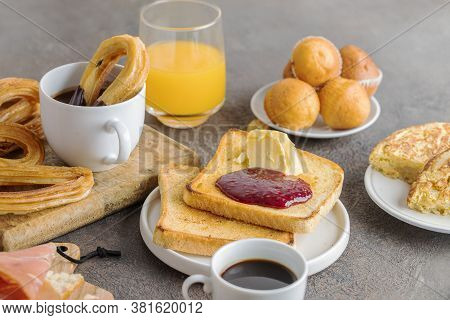 Spanish Breakfast, Churros With Chocolate,  Magdalena (spanish Cupcake) , Crusty  French Toast With