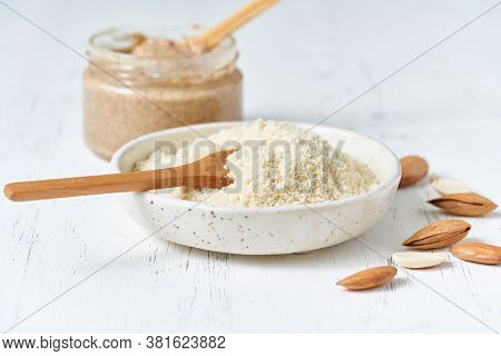 Alternative Almond Flour. Grated Crushed Almonds, Chopped In A Blender, Plate, Spoon, Nuts