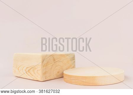 Wooden Textured Square And Round Podiums On A Light Background. Background For Product Photography,