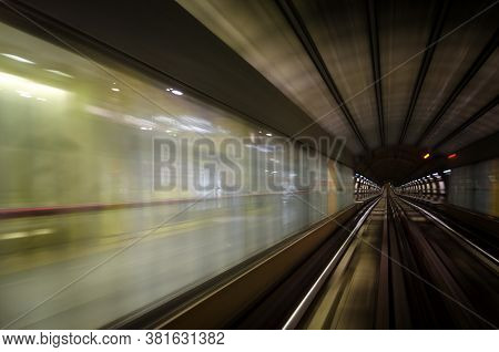Metro Subway Of Turin (italy), Dark Tunnel And Train Station With Rails And Motion Blur Seen From Th