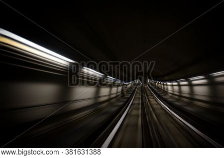 Metro Subway Of Turin (italy), Motion Blur Of A Dark Tunnel Seen From The Running Rain