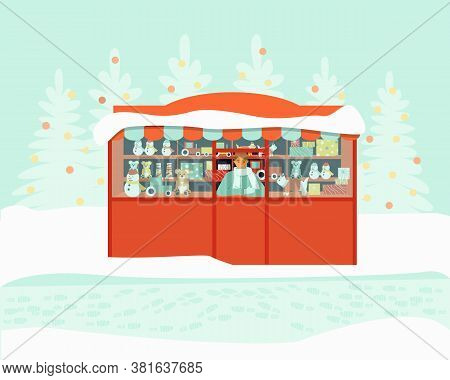 The Seller At The Toy Kiosk Is Waiting For The Buyers. The Store Sells Bears, Cars, Snowman. Winter