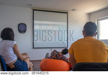 Sibenik Croatia August 2020 A Group Of Students Watching A Powerpoint Presentation Projected Onto Th