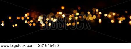 Black Background With Golden Light Effects. Horizontal Background With Blur Bokeh Effects For Christ