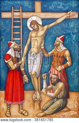 ZAGREB, CROATIA - FEBRUARY 19, 2013: 11th Stations of the Cross, Crucifixion: Jesus is nailed to the cross, parish church Precious Blood of Jesus in Zagreb, Croatia