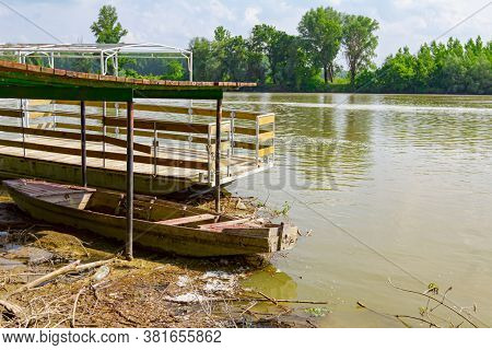Improvised Dock, Place For Landing Fishing Boats On Shore Of Polluted River.