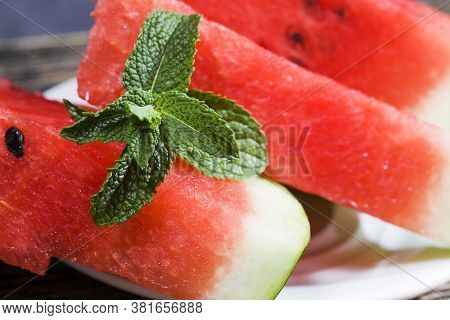 Ready-to-eat Chunks Of Red Watermelon With Sweet Delicious Flesh, Closeup Of Watermelon Flesh In Sum