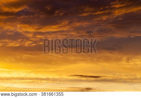 Beautiful Cloudy Sky During Sunset Or Dawn With Warm Colors And Shades, Natural Phenomena, The Sun A