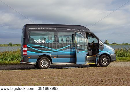 Almere, The Netherland - August 20, 2020: Nobelgo Small Autobus With Open Door Parked By The Side Of