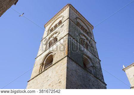 White Stork Flying Over Torre Julia Of Santa Maria La Mayor Church, Trujillo, Spain