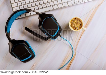 Call Center Operator In Support Table With Headset Headphones With Microphone, Keyboard Top View Cof