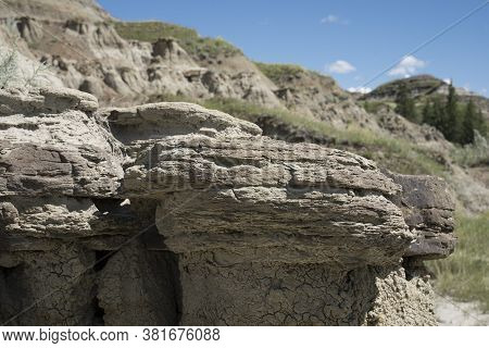 Eroded Rock Formations Showcasing The Geological Past On The Alberta Badlands.