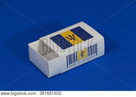 Barbados Flag On White Box With Barcode And The Color Of Nation Flag On Blue Background, Paper Packa