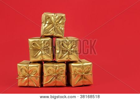 Gold Christmas Presents On Red Background