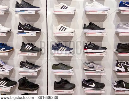 Kyiv, Ukraine - August 16, 2020: Adidas Superstar White And Black Shoes And Nike Sneakers At Popular