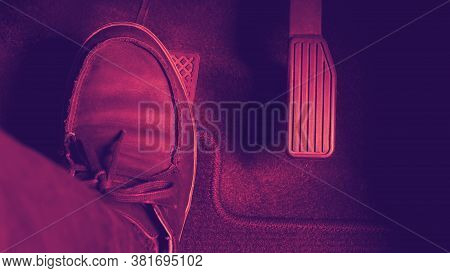 Man Foot And Accelerator And Brake Pedal Inside The Car Or Vehicle And Copy Space