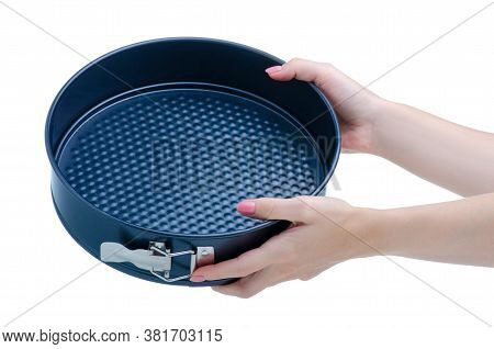 Round Metal Baking Dish In Hand On White Background Isolation
