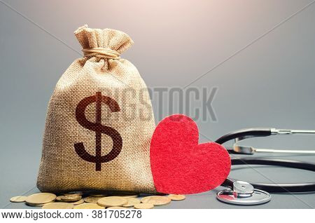 Dollar Money Bag And Stethoscope. Health Life Insurance And Financing Concept. Funding Healthcare Sy