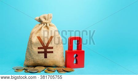 Yen Yuan Money Bag And Red Padlock. Blocking Bank Accounts And Seizing Assets. Tight Government Cont
