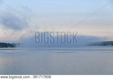 Morning Mist In Canoe Country On Agnes Lake In Quetico Provincial Park In Ontario, Canada